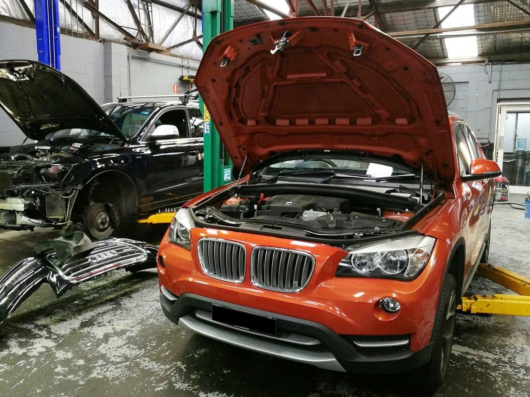 Orange BMW in Maintenance